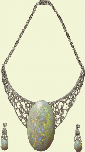 The Andamooka Opal is a famous opal that was presented to Queen Elizabeth II in the 1950s on the occasion of her first visit to Australia. It was discovered in Andamooka, South Australia, an historic opal mining town. The opal was cut and polished by John Altmann to a weight of 203 carats. It displays a magnificent array of reds, blues, and greens set with diamonds into an 18K setting.