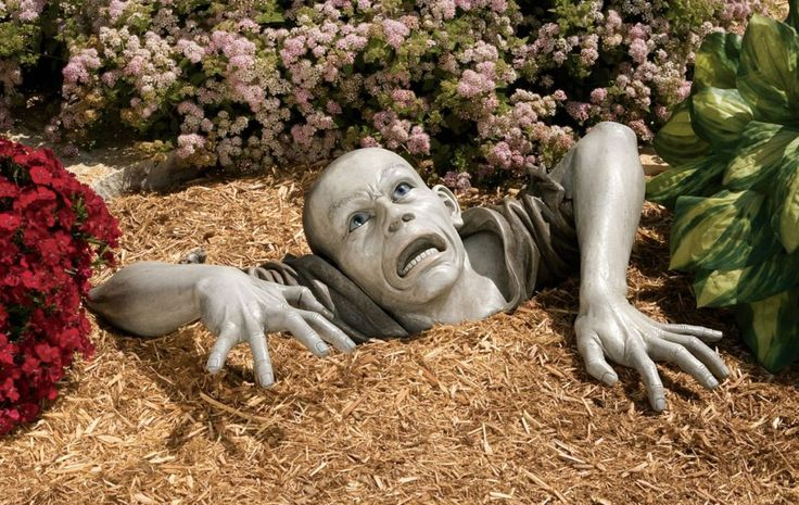 Unusual Garden Ornaments By Design Toscano This Is About The Strangest One I Have Seen Yet Zombie Zombies Coming Out Of Ground Alive Statues