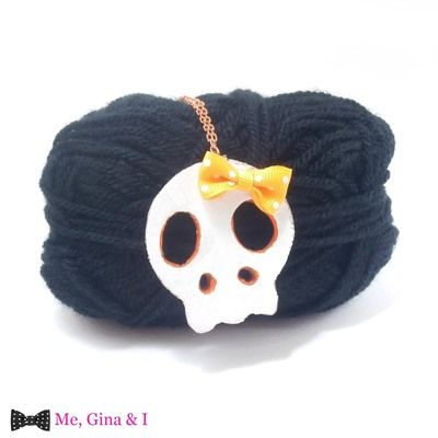 White & orange skull long pendant made of cork.