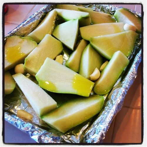 Chayote squash, garlic, olive oil. Bake for 30-40 min. on 425 degrees.