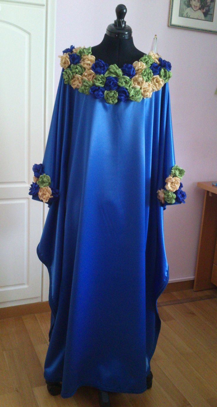 Blue long crepe satin caftan with handmade flowers sewn on it.