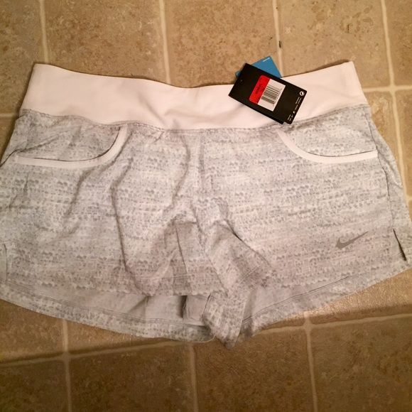 Nike shorts Women's Nike shorts size large. NWT! I love these! I just bought in a smaller size. Has under shorts. Nike Shorts