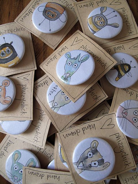 Lots of funky hand drawn badges! :) (cut out circles and do tiny art for buttons)