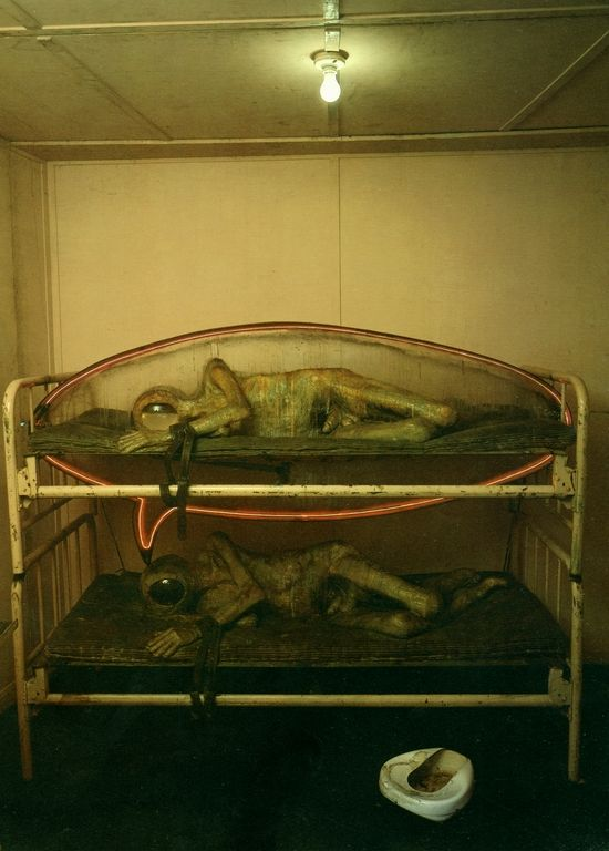 Edward Kienholz, State Hospital (interior), 1966. Fish bowl for a helmet. Bed pan just out of reach. Even in his thoughts he can't escape reality. Viewed only from the outside looking through bars. Super awesome.