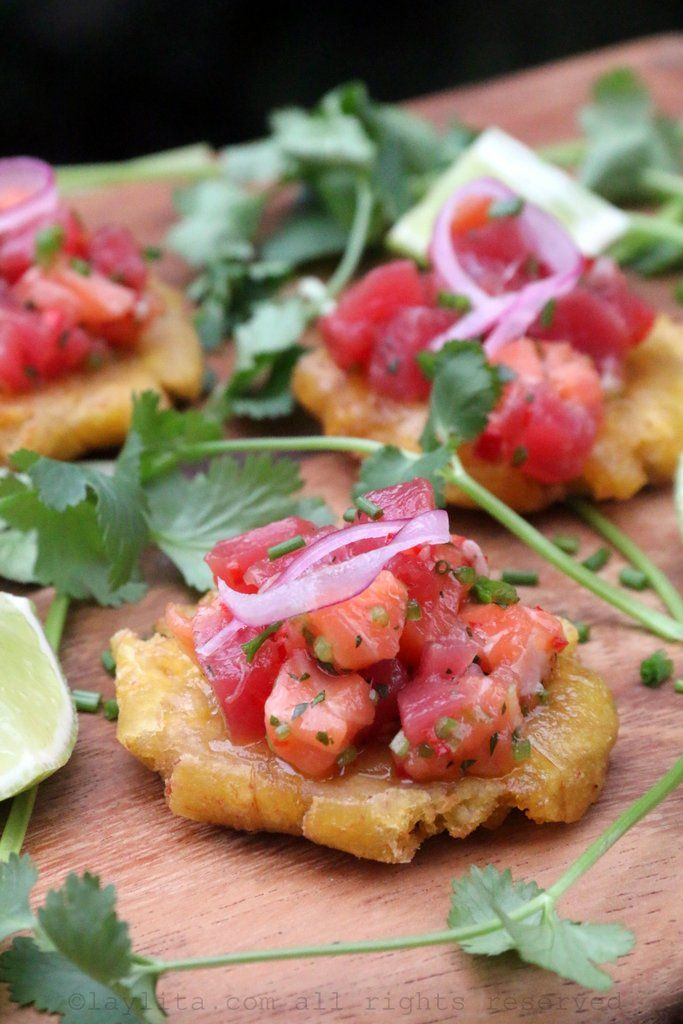 Patacones or tostones topped with tuna and salmon ceviche