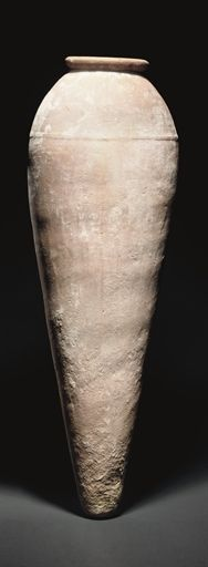 Egyptian pottery jar, Perdynastic period, 3100 B.C.  With rounded rim and slender ovoid body, tapering to narrow base, an encircling band in relief on the shoulder, 79 cm high. Private collection