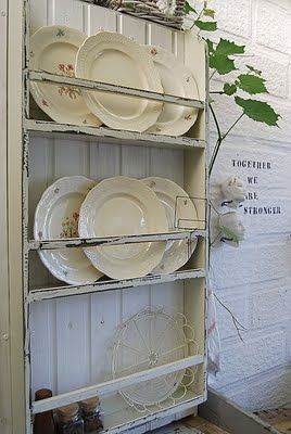 love the shabby chic plate rack, and the old plates are wonderful.....