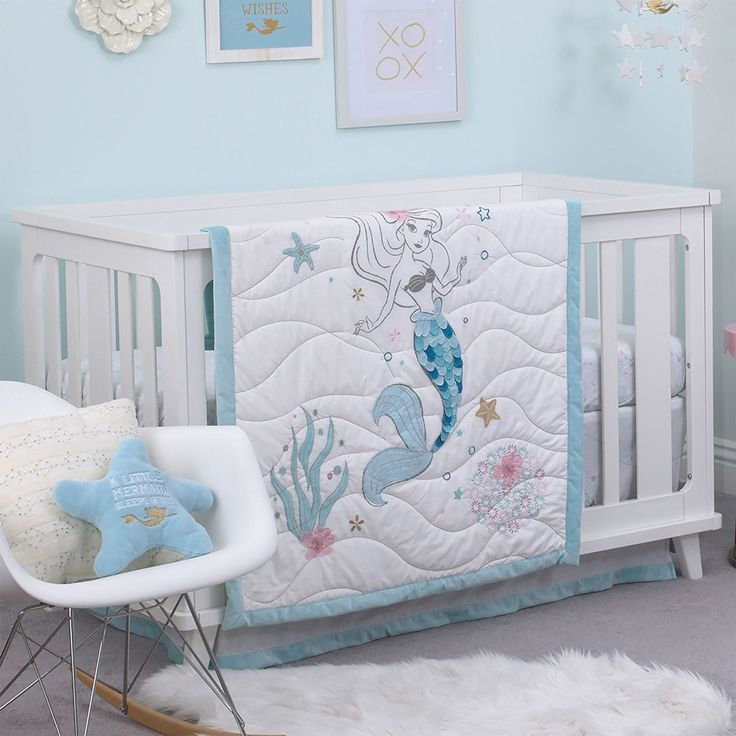 Ariel Sea Princess 3 Piece Crib Bedding Set, Blue/White/Gold/Pink. Surround baby with a bit of Disney magic. This sweet set includes a double-sided comforter featuring Ariel with soothing shades of aqua with touches of pink and gold, a fitted crib sheet on a sea-foam white background, and a dust ruffle in aqua and white with touches of pink. Coordinates with a complete collection of Ariel Sea Princess nursery decor and accessories perfect for your little mermaid.