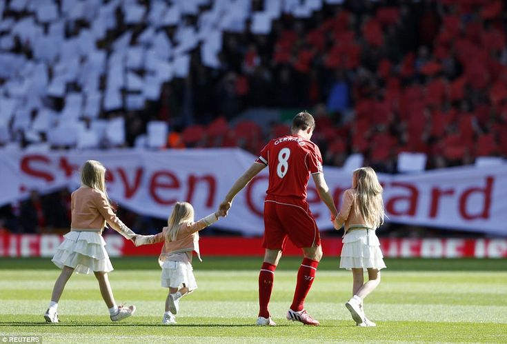 Leader: Liverpool's legendary captain Gerrard steps on the Anfield turf with his three dau...