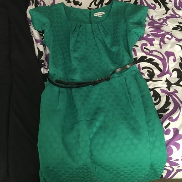 Bright green work dress with black belt Beautiful bright green color. With circles. Comes with cute black belt. The shoulders are a little puffy. Comes down to a little above the knee. Has pockets on the side. Never worn before. Dresses Midi