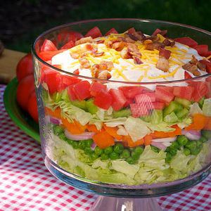 This delicious salad is always a welcome addition to the buffet table for family gatherings, bring-a-dish buffets and summer picnics. Inspired by a classic Southern favorite, this layered all-American salad looks beautiful in a clear glass bowl.