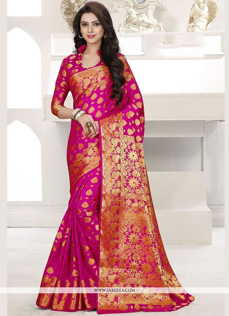 Be the sunshine of everybody's eyes dressed in such a beautiful hot pink banarasi silk traditional designer saree. This attire is displaying some really mesmerizing and creative patterns embroidered...