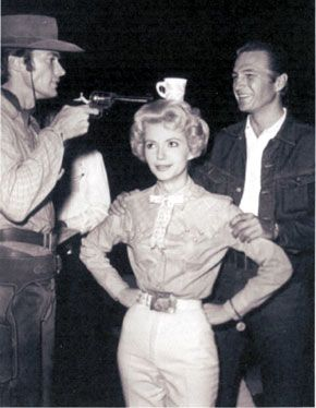"""""""At this range I can't miss!"""", sez Clint Eastwood as he clowns around with Ruta Lee and Eric Fleming on the set of """"Rawhide"""". (Thanx to Terry Cutts.)"""