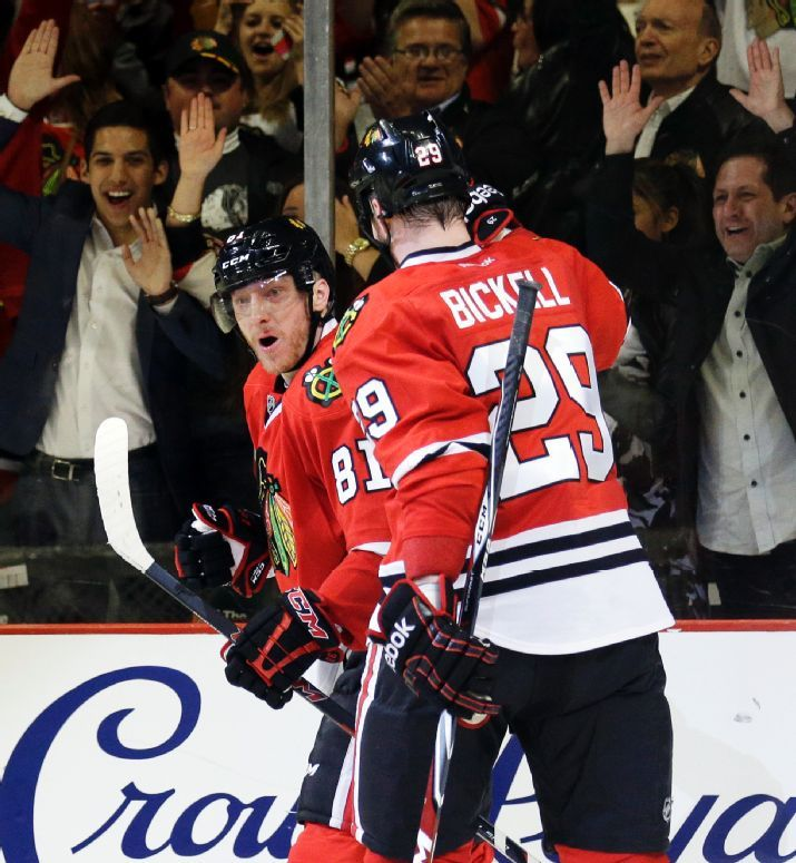 Chicago Blackhawks' Marian Hossa, left, celebrates with Bryan Bickell (29) after scoring a goal during the second period in Game 1 of an NHL hockey second-round playoff series against the Minnesota Wild in Chicago, Friday, May 2, 2014. (AP Photo/Nam Y. Huh)