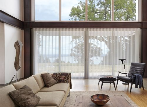 Even more beautiful than the translucency of sheer draperies, Luminette® Privacy Sheers offers sheer beauty with light control.  #HunterDouglas #windowtreatments #livingroom