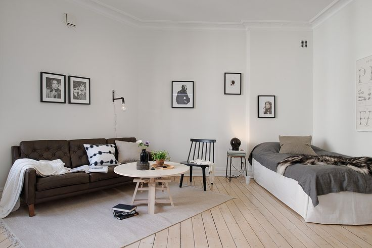 Cute little apartment with small framed photos around the walls. Looking for beautiful, unique and very affordable art photos to decorate your rental? Visit bx3foto.etsy.com