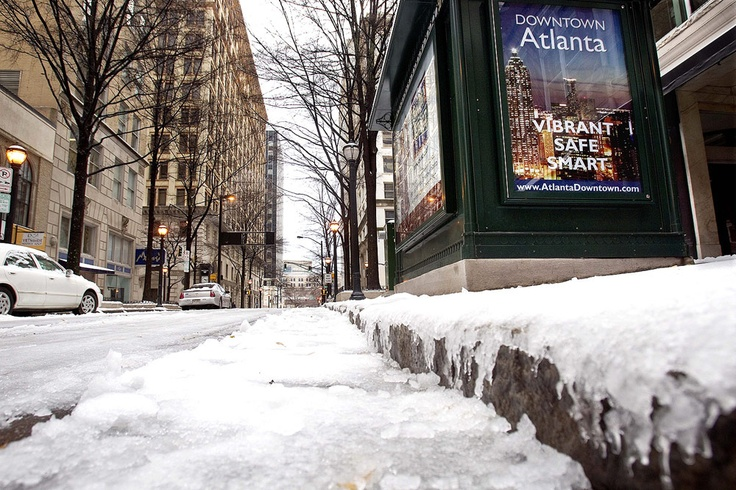 Broad Street, Atlanta, GA, 1/2011. North Georgia does get snow every year. ICY snow that causes damage, power outages and accidents. It is very dangerous and we aren't silly to stay at home when it comes down.