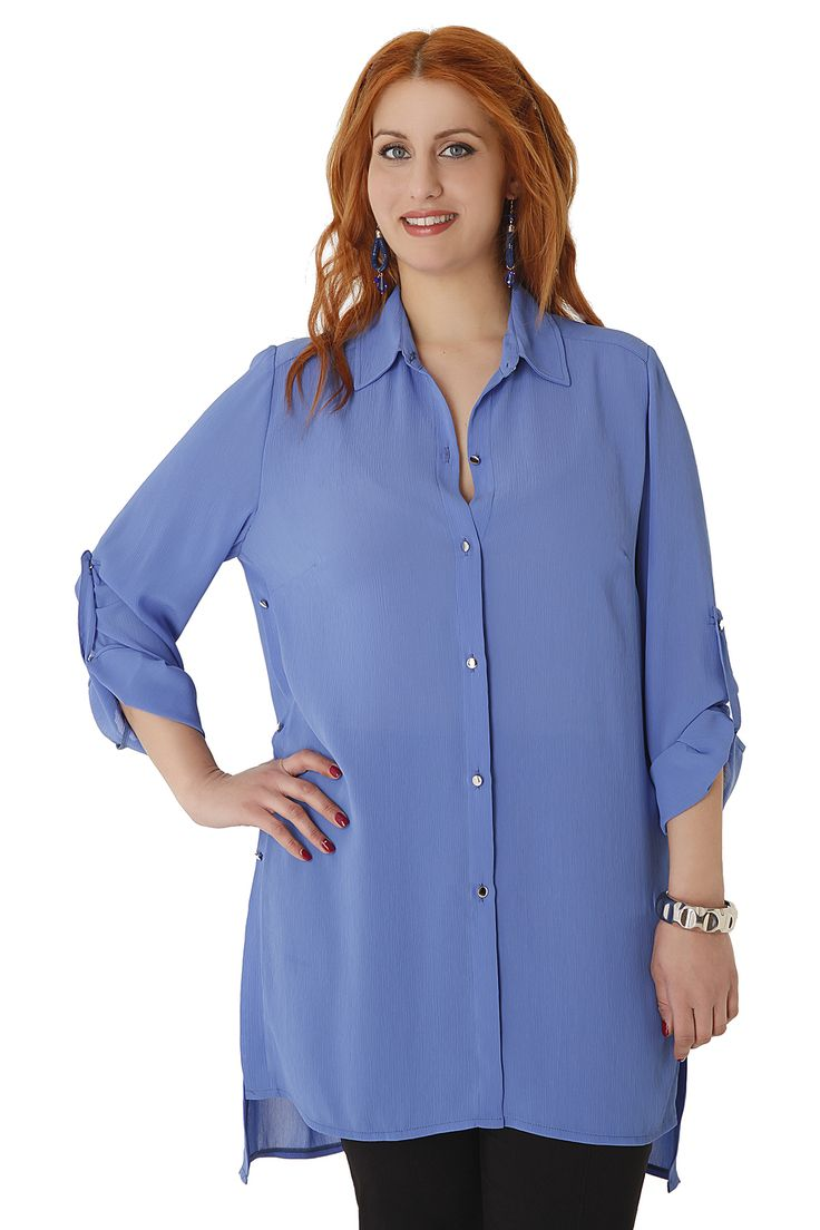 Airy longline shirt made of soft crepe. It has side slits, decorative metal buttons and rolled-up sleeves. Match it perfectly with elastic trousers for a night out or a pair of jeans for your everyday look. Available in 3 colours.
