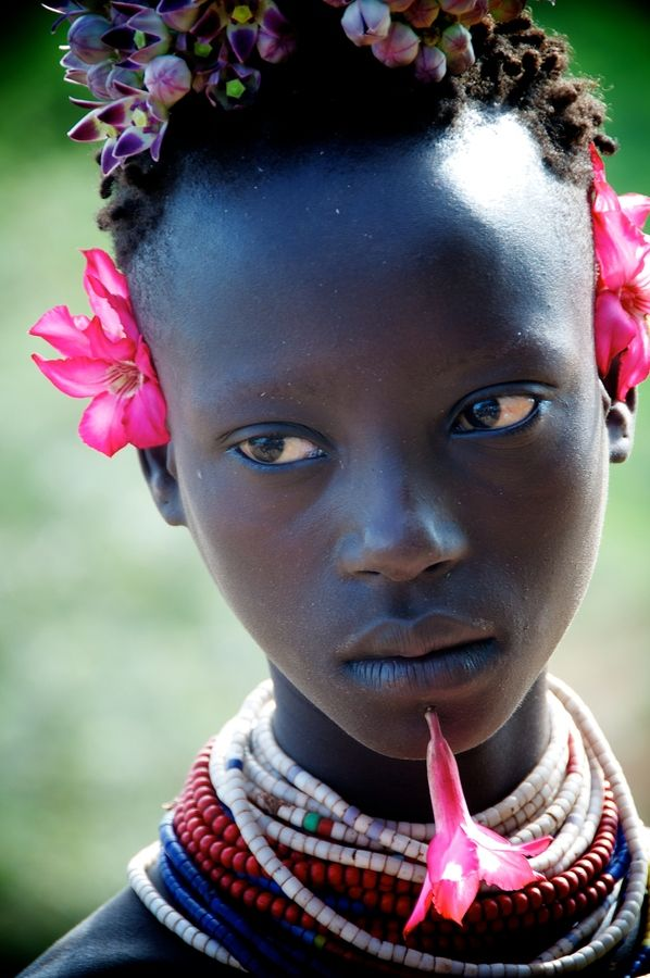 Karo Tribe, Ethiopia. tiny twists, now decorate with flowers. swoooooon