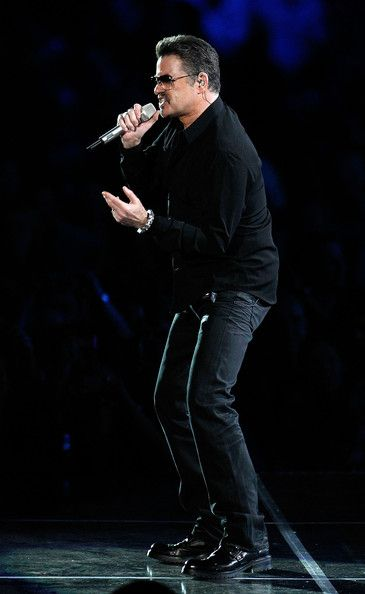 """George Michael Singer George Michael performs on stage in concert on the first night of his """"George Michael Live"""" Australian tour at Burswood Dome on February 20, 2010 in Perth, Australia."""