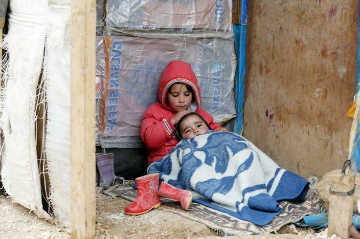 Just me' my little brother and this blanket. No mother ' no father' no house. Anybody care? # refugees.....