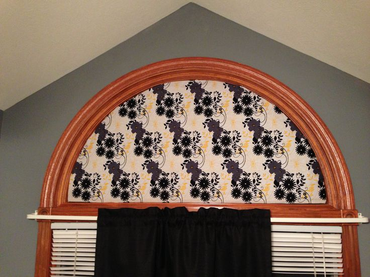 Cheap cover for a half moon window. Instead of buying really expensive blinds! Cardboard, quilt batting, and fabric!