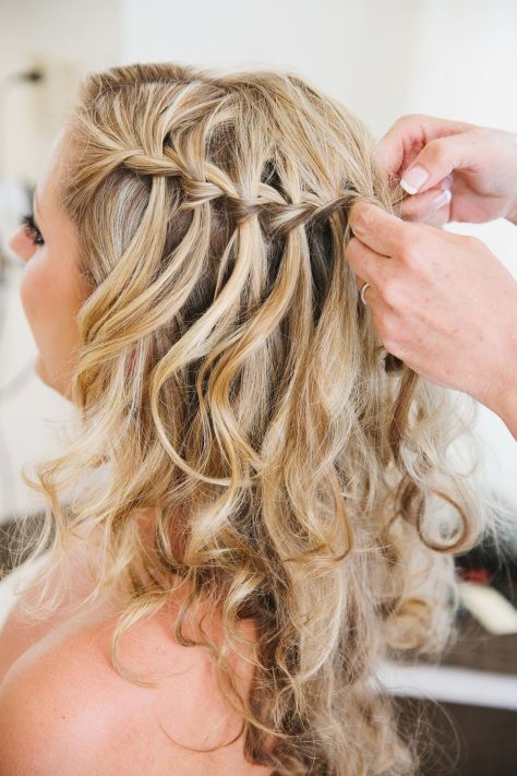 Loose curls with a simple but elegant braid detail makes the perfect beach wedding hairstyle.