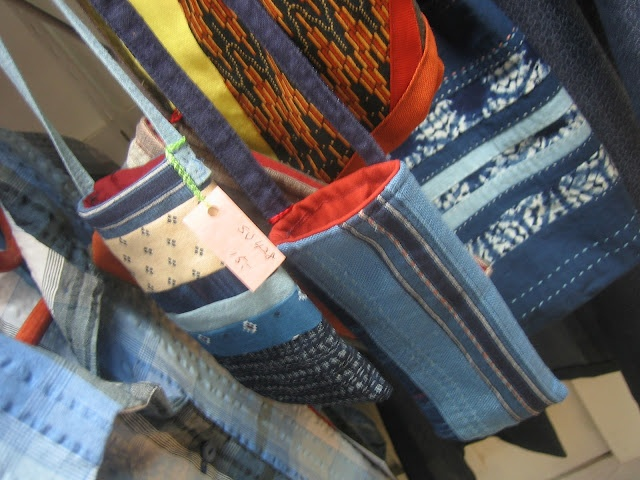 Textures:a combined effort of area artisansa.k.a. Textures Craftworks  -denim pouch bags by Sumi Nogami - $15 and up