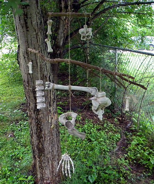 "Witch Chimes.... this inspired me: could buy some cheap bones or ""body parts"" from the dollar store or Big Lots and hang off the porch"
