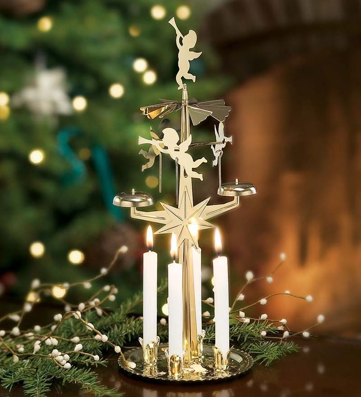 Twirling Holiday Angel Christmas Chimes $16.95 and $9.95 for candles  I really want one of these because my grandma had one for Christmas.  It reminds me of her when I was little.