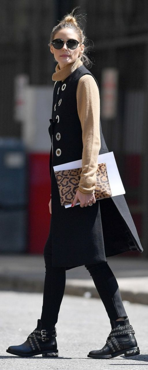 Who made Olivia Palermo's tan sweater, black lace up vest, tan turtleneck sweater, leopard clutch handbag, and black ankle boots?