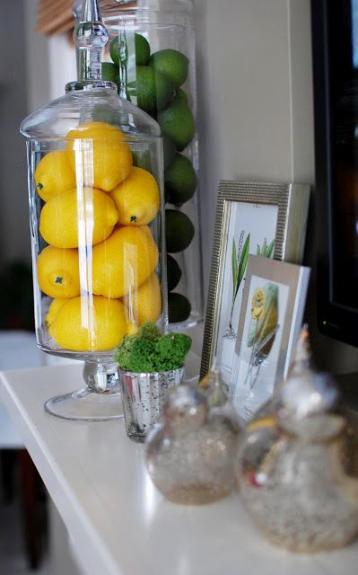 Dollar Tree has these lemons/limes//Giving Your Mantel A Fresh Look with Spring Decor - HomeandEventStyling.com