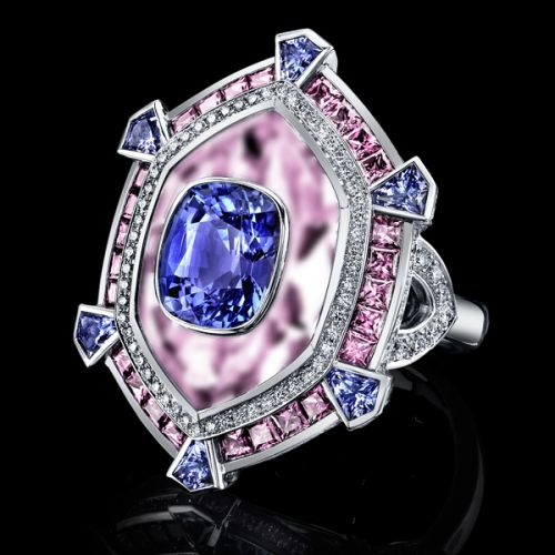 ASapphireJubileeStarRing Like the six points of a star, with complimentary accenting hues this unheated blue sapphire is held in complimenting pink quartz with pink sapphire and a spray of white diamonds.  All gems are precision set in hand crafted 18K white gold.