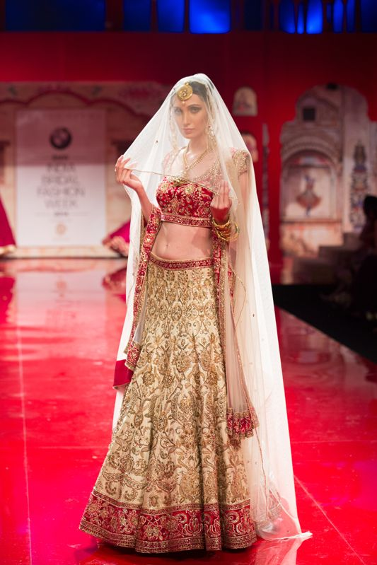 Red white cream Indian wedding lehenga by Suneet Varma. More here: http://www.indianweddingsite.com/bmw-india-bridal-fashion-week-ibfw-2014-suneet-varma/