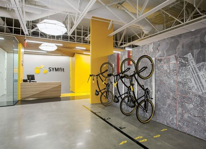 Gensler San Jose's Fitness Center for Symantec | Near reception, vinyl wall covering is printed with an aerial map of the area, with biking routes highlighted. Indoor bike rack at SWAT