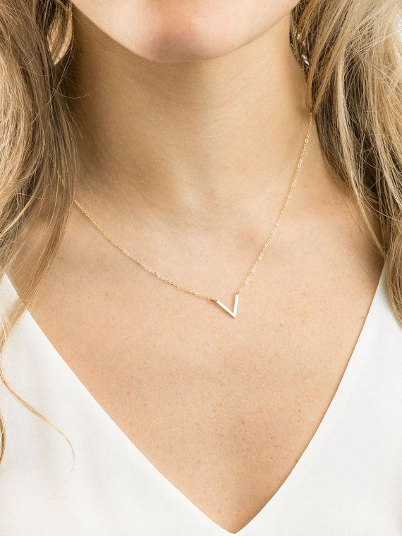 Dainty Necklace in Gold Fill or Sterling Silver. Tiny V pendant suspended in delicate, strong chain. Choose a gorgeous hand-hammered texture or a subtle satin finish for your V. …………………………………. KNOWLEDGE ∙ LN141_10 - 100% 14k Gold Filled or Sterling Silver - 100% top quality USA and Italian made components - Delicate, Strong Chain - Hand-crafted V Pendant: sides are 12mm …………………………………. FINISH In the 2nd Drop Down menu, choose the finish youd like for your tiny V: smooth : Semi-shiny sati...