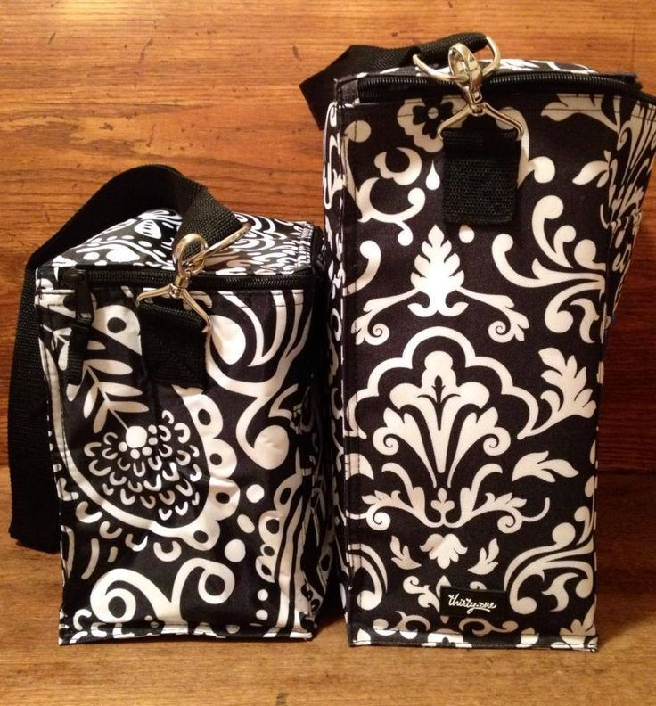 Thirty one Around the Clock vs picnic Thermal. Available in other patterns too! Picnic thermal holds 3 stacked 6 packs and the Around the Clock Thermal holds one. Check these and other thermals out at www.jennpennbags.com
