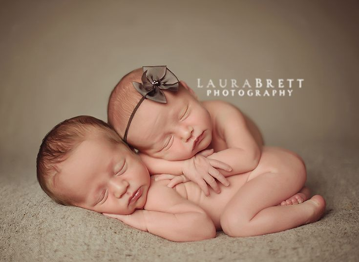 Snuggled up newborn twinsbaby