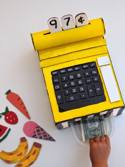 Make Your own Cash Register out of Cardboard!  It has pressable buttons, sliding money drawer, a faux credit card scanner, and a changeable display!