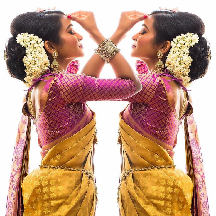South Indian bride. Gold Indian bridal jewelry.Temple jewelry. Jhumkis.Yellow silk kanchipuram sari.Bun with fresh jasmine flowers. Tamil bride. Telugu bride. Kannada bride. Hindu bride. Malayalee bride.Kerala bride.South Indian wedding.