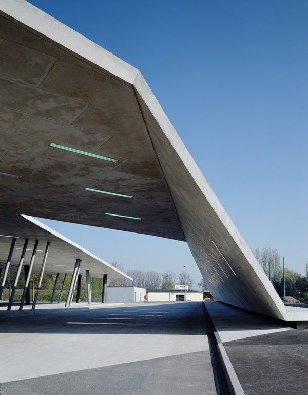 Zaha Hadid Architects | Terminus Hoenheim-Nord Strasbourg Concrete pavement folds into the roof canopy over the terminus