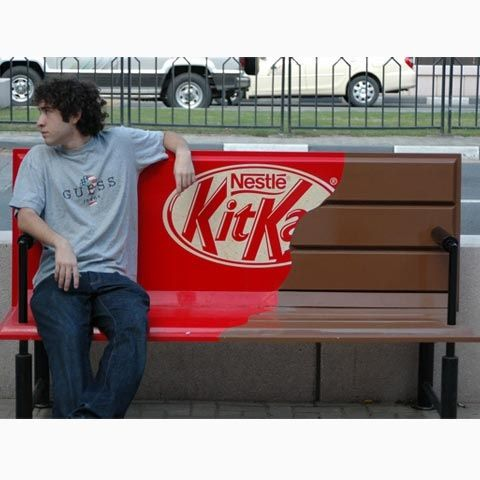 This is a neat idea for an advertisement.  Kit Kat's slogan is break me off a piece of that kit kat bar.  The bench are actual kit kat pieces and the wrapper signifies the breaking.  They took something very ordinary and use it to create something great.