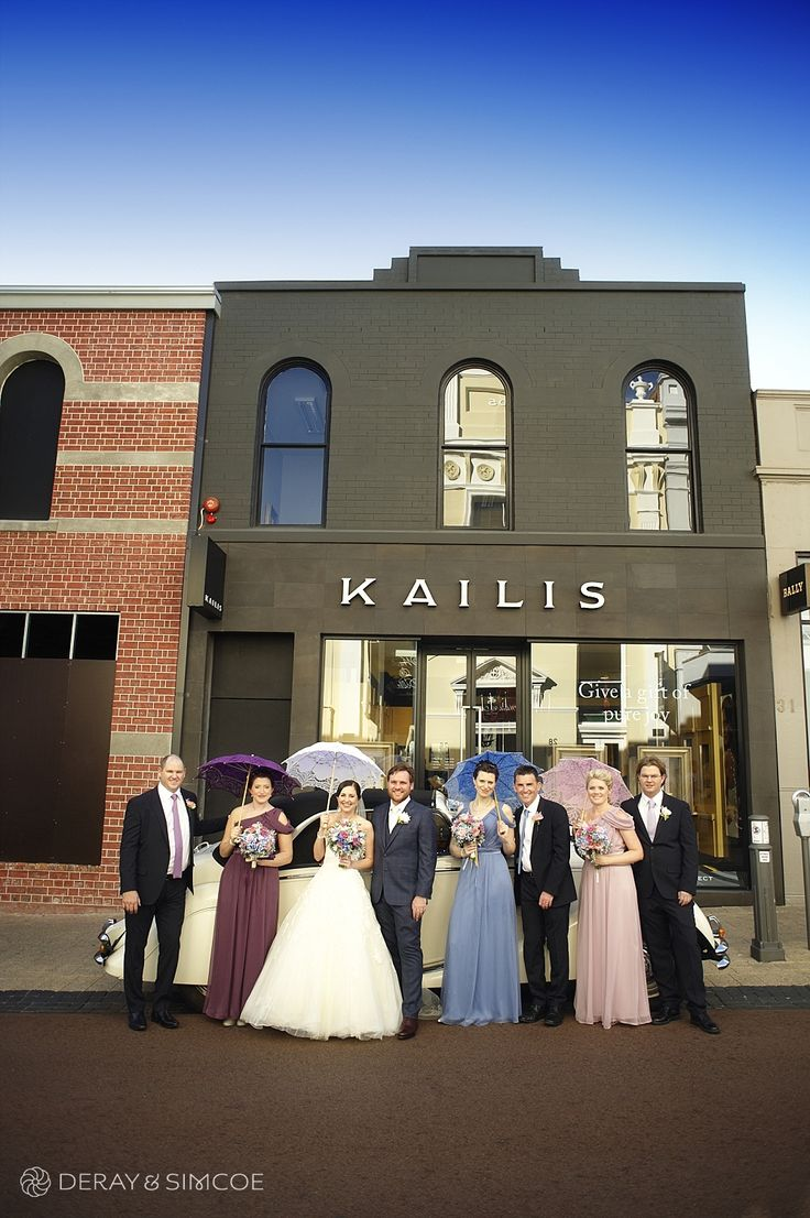 Vintage inspired bridal party. Multicolored bridesmaids in pink, purple and pale blue with lace parasols  Location ~ King Street, Perth  Photography by DeRay & Simcoe