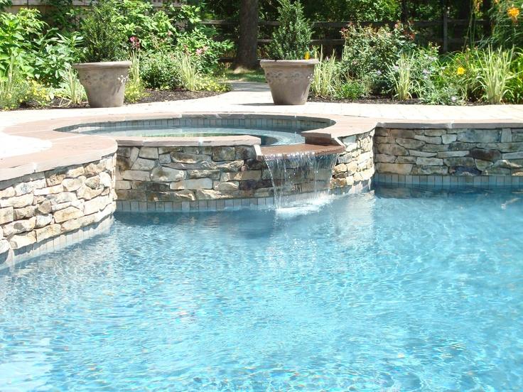 Natural Stone On Raised Spa And Radius Cut Flagstone Coping Around Spa Perimeter Spas