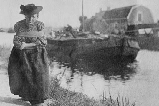 A Older Dutch woman has a bustle around her chest as she pulls a barge down a canal. - Art Print  #9780587459101 #Buyenlarge #Canal #New