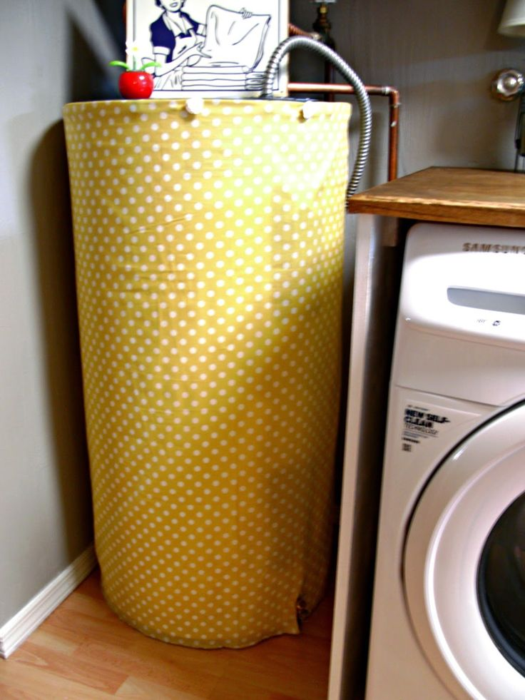 hide an ugly water heater with magnets and cute fabric. genius | Little Vintage Cottage: Laundry Room Redo