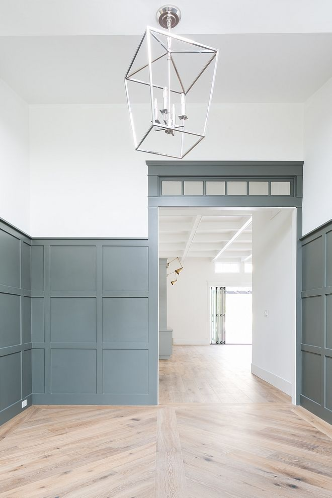 Grey Grid Board And Batten Paneling The Front Door Opens To An Impressive Foyer With Grey Grid Board And Batten Paneli Craftsman Living Rooms Custom Homes Home