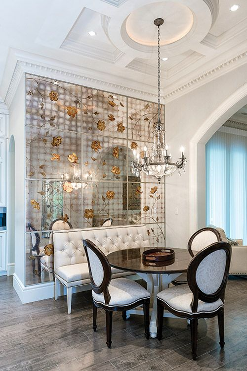 Stunning handcrafted verre églomisé walls add both depth and emotion to the magnificent breakfast nook.