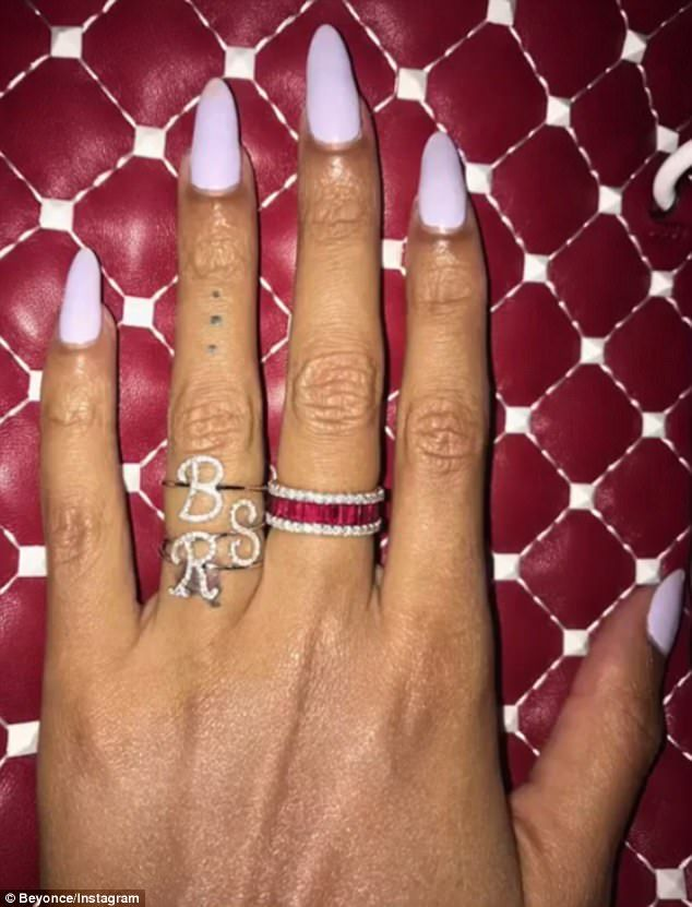 Baby bling: She displayed initial rings for her daughter Blue Ivy Carter and twins Sir and Rumi