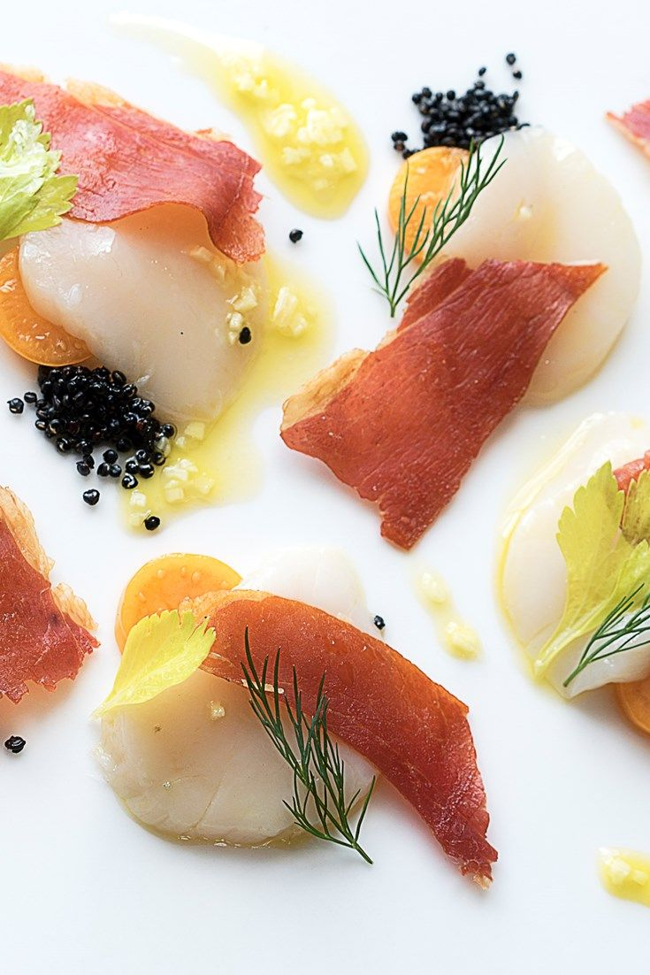 A stunning scallop ceviche recipe, this scallop starter has plenty of zingy flavour from yuzu and ginger, and added texture from crispy prosciutto and quinoa.